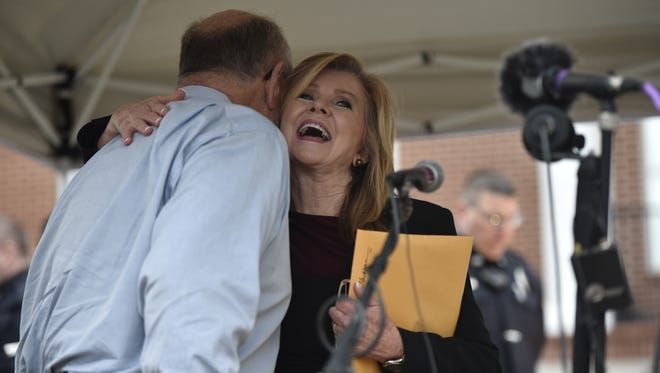 U.S. Rep. Marsha Blackburn hugs Bernie Ellis, who helped organize the alternative town hall after her town hall meeting Tuesday, Feb. 21, 2017, at Fairview City Hall.
