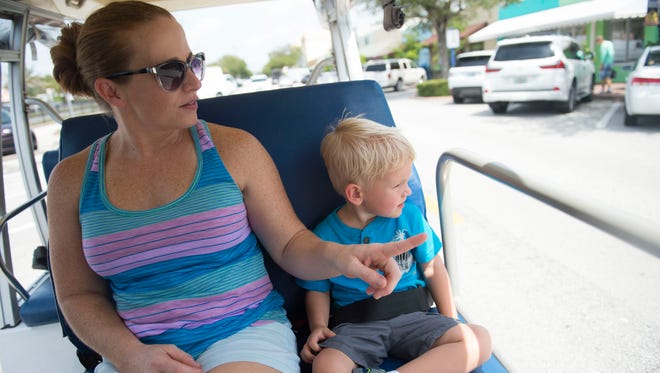 Jennifer Hannon (left) and son, Cooper, 2, of Stuart, take a lap on the Stuart courtesy tram to cool off before being dropped off at Kiwanis Youth Park on Aug. 28, 2017, in Stuart. About 52,000 riders use the tram each year, according to Teresa Lamar-Sarno, special assistant to the Stuart city manager.