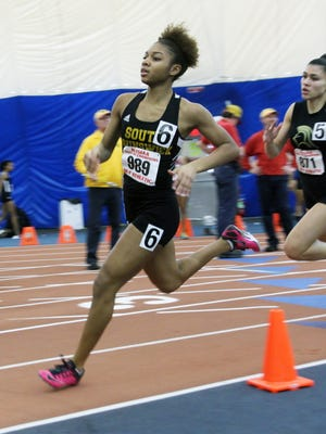 South Brunswick's Desirae Osley competes during the 400 meter dash at the 2015 NJSIAA Winter Track Meet of Champions.