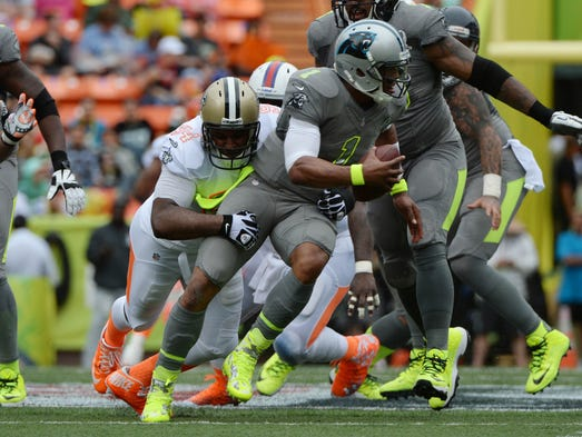 Team Rice defensive end Cameron Jordan of the New Orleans Saints (94) sacks Team Sanders quarterback Cam Newton of the Carolina Panthers (1) during the second quarter of the 2014 Pro Bowl at Aloha Stadium.
