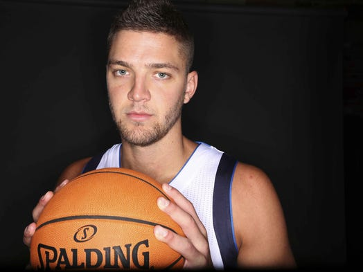 Dallas Mavericks forward Chandler Parsons poses for a photo during NBA basketball media day in Dallas, Monday, Sept. 29, 2014.