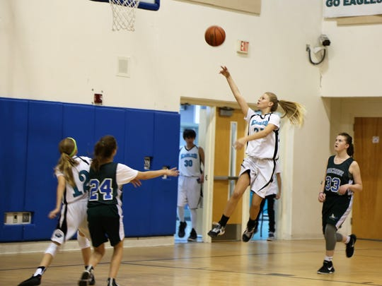 Kylee Mitchell shoots for a point.