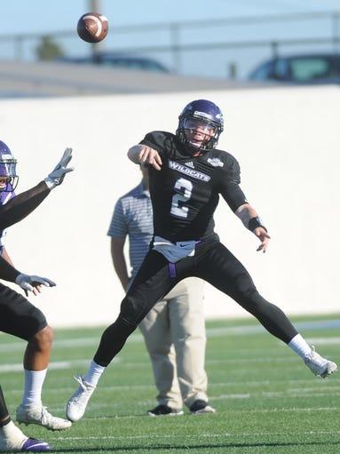ACU quarterback Dallas Sealey (2) throws a pass during