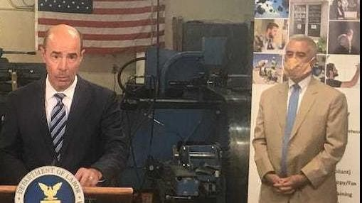 U.S. Secretary of Labor Eugene Scalia, left, announces a $20 million grant to help fight the opioid epidemic in southern Ohio and three other states as Rep. Brad Wenstrup, a Republican who represents Ohio's 2nd Congressional district in southern Ohio, looks on at right. Scalia made the announcement during a visit on Wednesday, Aug. 26, 2020, to Ohio Valley Veneer in Piketon.