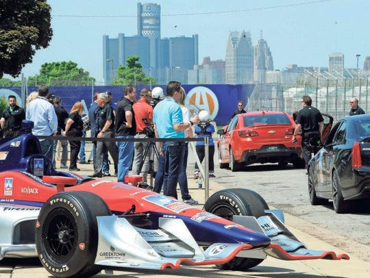 Simon Pagenaud and other Indy car drivers take media members for a spin on the Belle Isle track.