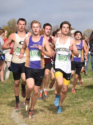Waynesboro's Chandler Showalter, left, and Stuart Vailes, far right, compete in the boys race at the Region 3A West country meet at the Virginia Horse Center in Lexington, Va., on Tuesday, Nov. 1, 2016.