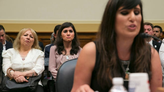 Bibi Abedini, mother of Saeed Abedini, who is being held in Iran, left, and her daughter Zibandeh Abedini, listen as his wife Naghmeh Abedini, testifies on Capitol Hill in Washington Tuesday  in a House Foreign Affairs Committee hearing.