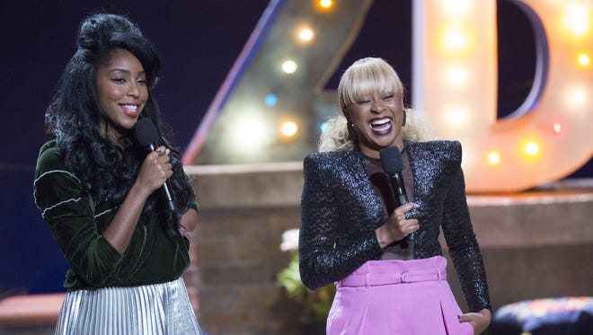 Jessica Williams, left, and Phoebe Robinson take the stage for their HBO specials that have the same name as their popular podcast, '2 Dope Queens.'