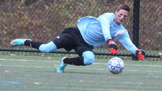 Mamaroneck goalie Thomas Orgielewicz makes a save during the Tigers' Class AA boys soccer semifinal against  Port Chester at Purchase College Oct. 29, 2014.