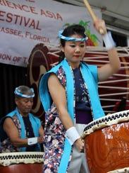 Members of the Japanese Matsuriza Taiko drummers storm
