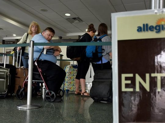 MICHAEL PATRICK/NEWS SENTINEL Allegiant Air passengers wait in line to check in at Knoxville's McGhee Tyson Airport Wednesday, May 25, 2016. Memorial Day is one of busiest days of year for air travelers. Allegiant just launched new nonstop flights to Destin, Fla.