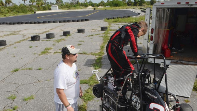 John Nevins watches his son Ty get into his Quarter Midget race car at the new track at Valkaria Airport.