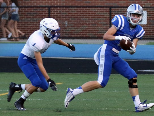 Whitefish Bay's Alex Anthony makes a reception agaiinst