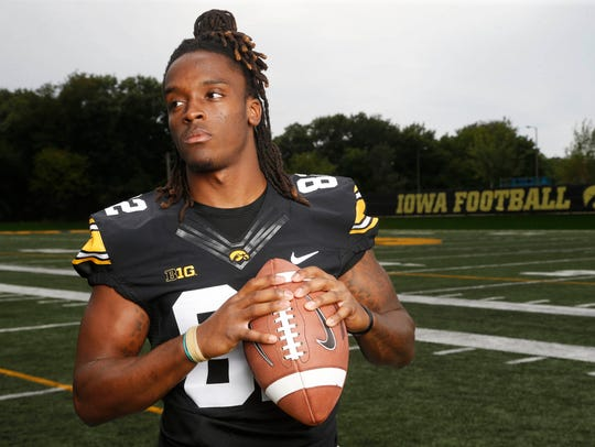 Hawkeye wide receiver Adrian Falconer (82) poses for
