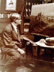 """Charlie Russell paints """"Salute to the Robe Trade"""" at his Great Falls studio in 1920."""
