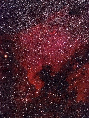 The famed North American Nebula (NGC 7000) in Cygnus, somewhat resembles the continent. At right is the Pelican nebula. [Photo by Oliver Stein (Own work) [CC BY-SA 3 (https://creativecommons.org/licenses/by-sa/3)], via Wikimedia Commons]