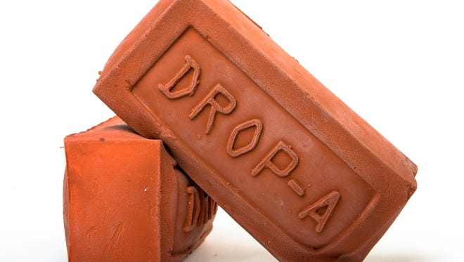 The rubber brick from Drop-A-Brick 2.0, to displace water in toilet tanks.