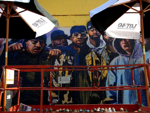 Murals in the market showcases artists 39 work at eastern market for Eminem wall mural