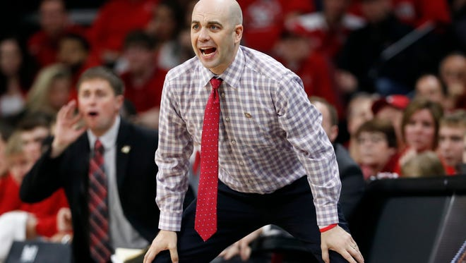 South Dakota head coach Craig Smith watches from the bench during the second half of a first-round game in the NIT college basketball tournament against Iowa, Wednesday, March 15, 2017, in Iowa City, Iowa. Iowa won 87-75.