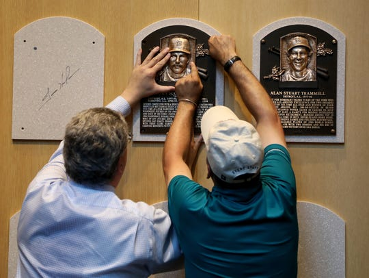 Erik Stroehl, vice president of exhibitions and collections, helps Mike Fink, manager of exhibits at the National Baseball Hall of Fame and Museum in Cooperstown, N.Y., with the installation of the Hall of Fame plaque of Jack Morris, left, and Alan Trammell on Sunday.
