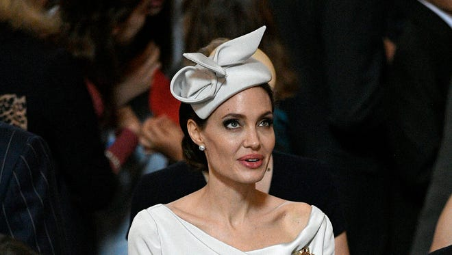 Angelina Jolie gave fashion fans Duchess Meghan vibes with her Ralph & Russo dress and fascinator.