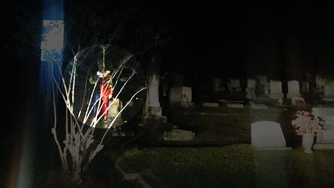 A clown can be seen in the highlighted area of this photo of a cemetery in McComb.