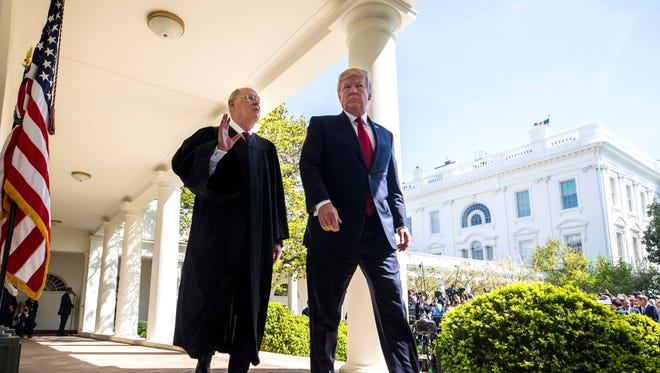 Justice Anthony Kennedy and President Donald Trump on April 10, 2017.