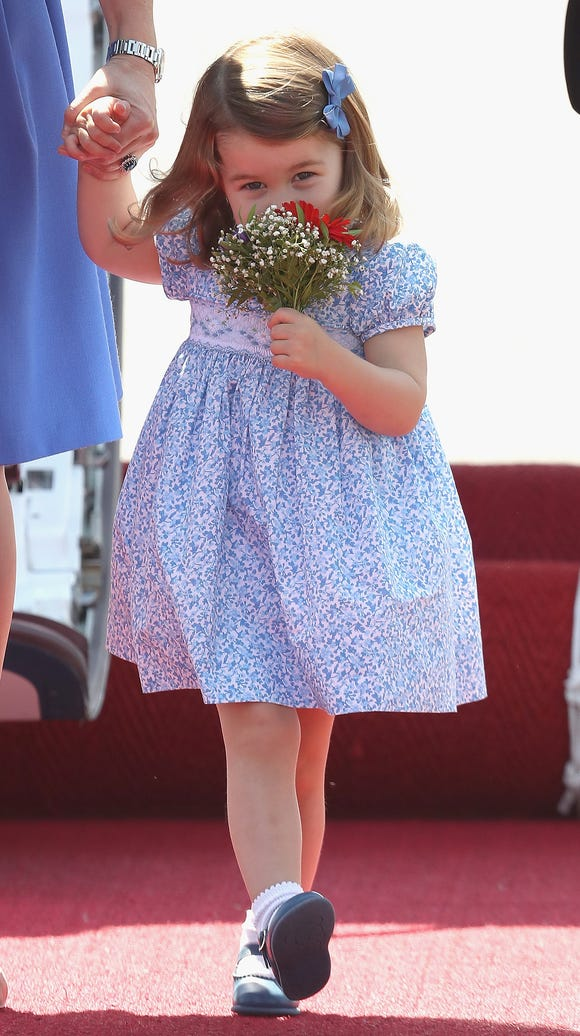 Holding her flowers like a blushing bride.