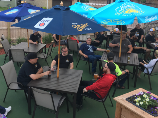 Customers flock to the new outdoor dining patio at Fourth-N-Long, 8911 W. National Ave., West Allis, that offers flowers on one side, fresh greenery on the other and umbrellas overhead.