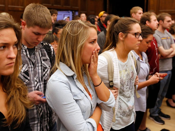 Iowa State University freshman Tiffany Wurst, center, of Urbandale, reacts with fellow students as Iowa State University president Steven Leath announces the suspension of VEISHEA Wednesday on the Iowa State campus in Ames.
