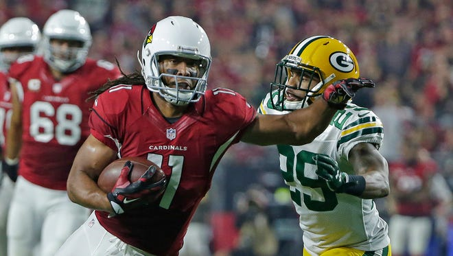 Green Bay Packers cornerback Casey Hayward (29) closes in on Arizona Cardinals wide receiver Larry Fitzgerald (11) after a catch at University of Phoenix Stadium.