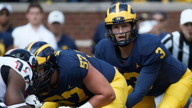 Sep 9, 2017; Ann Arbor, MI, USA; Michigan Wolverines quarterback Wilton Speight gets set to take the snap from center Patrick Kugler in the first half against the Cincinnati Bearcats at Michigan Stadium.