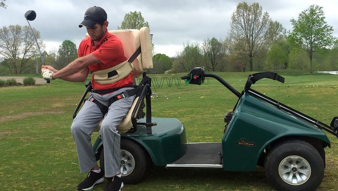 After being paralyzed from the waist down as a result of a hunting accident, D.J. Adcock is able to play golf again using a SoloRider.