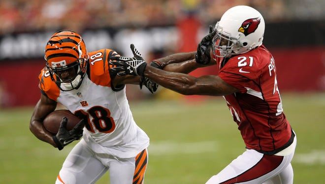 Cardinals cornerback Patrick Peterson chases Bengals receiver A.J. Green during a 2014 preseason game.