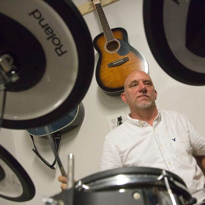 The owner of Second Hand Music, Joseph Smith, plays