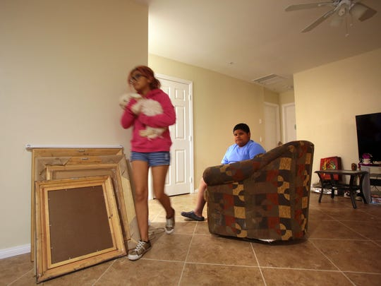 Naila Gamino, 17, and her uncle Camilo Ramirez, 11, at home in Coachella on Wednesday. The house they live in is built under a Coachella Valley Housing Coalition program where home owners built their own house.