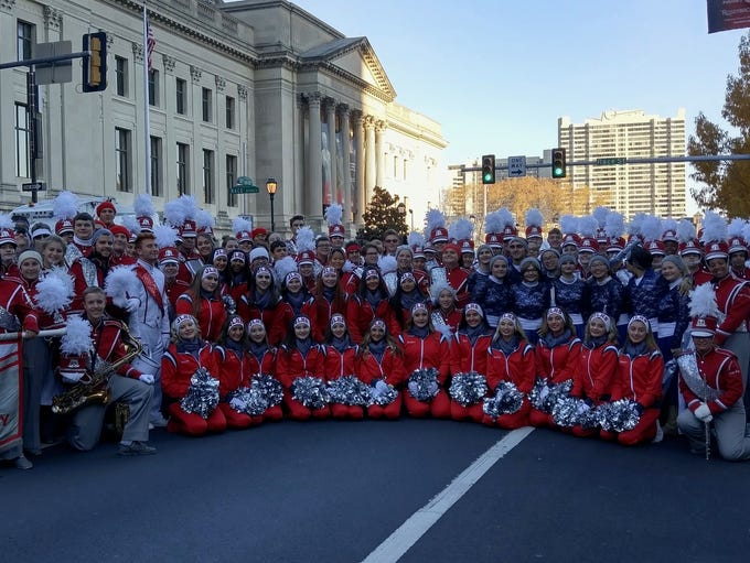 The Jackson Liberty High School Lion Band march in