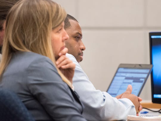 Alonzo Dewayne Thompkins Jr., 28, and his attorney, Marci McCoy, left, listen to testimony Tuesday in Escambia County court. Thompkins is on trial for first-degree murder in the death of his girlfriend's son, Cornelius Savage.