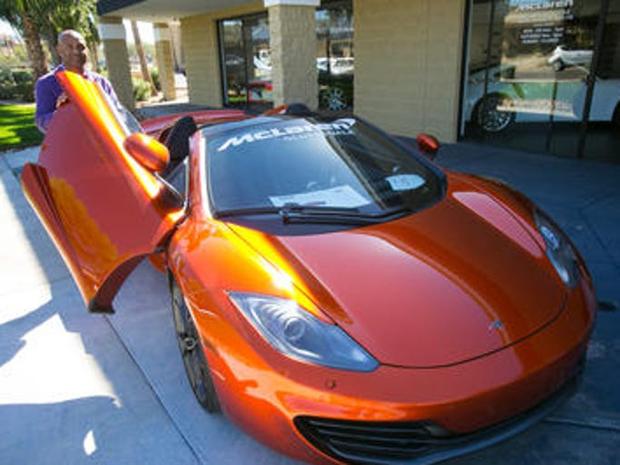 Mark Haynes shows the McLaren P1 sports car in Scottsdale.