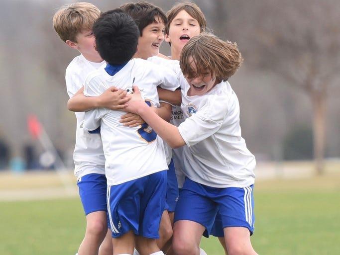 Boys U11 soccer team wins state championship.