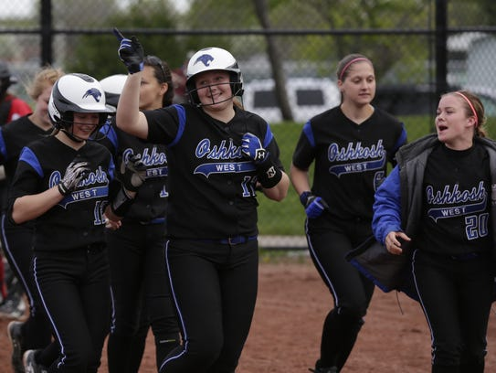 Oshkosh West's Alyssa Brewer, center, celebrates with