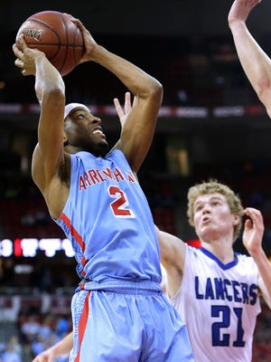 Arrowhead's Trevell Cunningham (left) drives past   Brookfield Central's Chris Post.