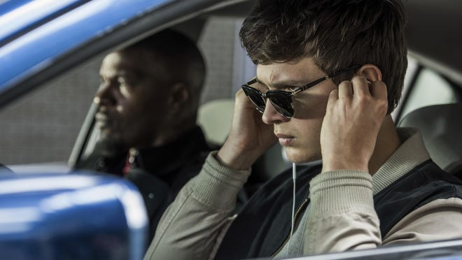 """Ansel Elgort, right, and Jamie Foxx appear in a scene from """"Baby Driver."""""""