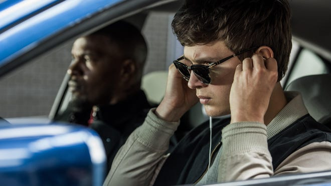 """Ansel Elgort (right, with Jamie Foxx) plays a getaway driver determined to leave his past behind in """"Baby Driver."""""""