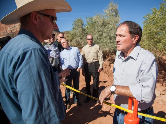 Gov. Gary Herbert visits with a Hildale City resident who filmed one of the videos of cars being swept away by recent flooding Saturday, Sept. 19, 2015.