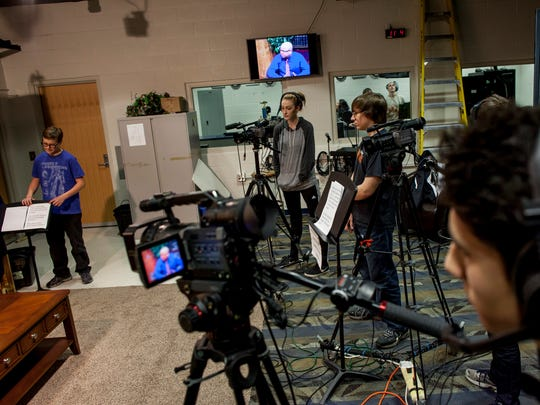 Students work on filming an interview in the communication arts studio Wednesday, Jan. 13, 2015 at Marysville High School.