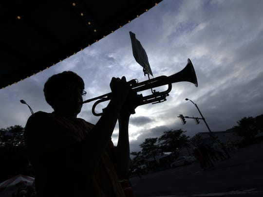 Aidam Sciortino of Rochester plays the trumpet at the