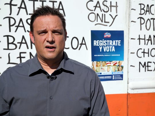 """Thomas Hull, a local design and marketing executive, is interviewed in front of the Tierra Caliente taco truck, one of eight trucks in Houston on Thursday, Sept. 29, 2016, that his firm and Mi Familia Vota have designated as voter registration sites. Hull said he was influenced when a surrogate of Republican presidential candidate Donald Trump recently suggested that unless the United States fortifies its borders and tightens immigration limits, """"You're going to have taco trucks on every corner."""""""