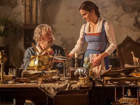 Kevin Kline, left, plays Belle's father Maurice in