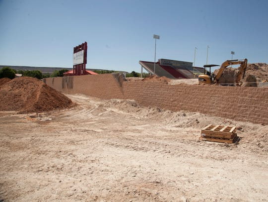 Construction crews work on DSU's new south practice